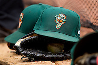 Greensboro Grasshoppers hats sit on the dugout steps at L.P. Frans Stadium on May 18, 2011 in Hickory, North Carolina.   Photo by Brian Westerholt / Four Seam Images