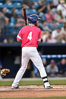 Asheville Tourists left fielder Max White (4) awaits a pitch during a game against the Rome Braves on May 15, 2015 in Asheville, North Carolina. The Braves defeated the Tourists 6-0. (Tony Farlow/Four Seam Images)