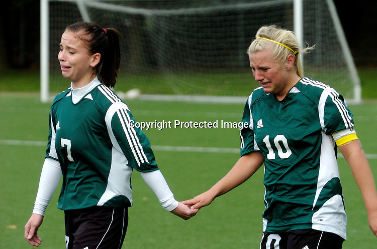 Shoreline Community College's Tamara Johnson, left, and Sara Lane cry and hold hands after their 1-0 loss to Walla Walla CC in the semifinals of the NWAACC Championships Saturday November 22, 2008 at Starfire Stadium in Tukwila, WA. Walla Walla scored the only goal of the game in the first 55 seconds of play.