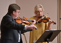 STAFF PHOTO BEN GOFF  @NWABenGoff -- 12/13/14 Valerie Bell performs a violin duet with instructor Will Bush during the Will Bush Violin Studio holiday recital at the Shiloh Museum of Ozark History in Springdale on Saturday Dec. 13, 2014.