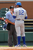 Daytona Cubs manager Brian Harper #12 argues a call with umpire Ramon Hernandez during a game against the Lakeland Flying Tigers at Joker Marchant Stadium on April 29, 2012 in Lakeland, Florida.  Lakeland defeated Daytona 6-4.  (Mike Janes/Four Seam Images)