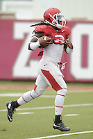 NWA Democrat-Gazette/ANDY SHUPE<br /> Arkansas running back Alex Collins carries the ball Tuesday, Aug. 18, 2015, during practice at the university's practice field in Fayetteville.