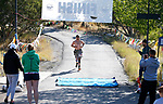 Half marathon runner Jay Gilbert crosses the finish line in the 8th annual Take it to the Lake race at Cave Lake State Park, near Ely, Nev., on Saturday, Sept. 21, 2019.<br /> Photo by Cathleen Allison/Nevada Momentum