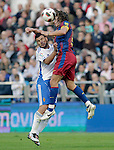 FC Barcelona's Carles Puyol (r) and Real Zaragoza's Braulio Nobrega during La Liga match.October 23,2010. (ALTERPHOTOS/Acero)