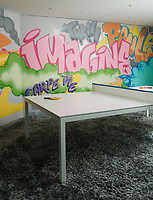 The chidren's playroom is fun with a graffiti wall, a shag rug and a ping-pong table.
