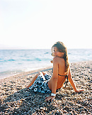 CROATIA, Bol, Brac, Dalmatian Coast, portrait of a woman relaxing in Zlatni Rat beach