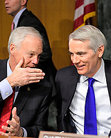 """United States Senator Ron Johnson (Republican of Wisconsin), left, and US Senator Rob Portman (Republican of Ohio), right, share a private conversation prior to hearing testimony before the US Senate Committee on Homeland Security and Governmental Affairs Permanent Subcommittee on Investigations during a hearing on """"Examining Private Sector Data Breaches"""" on Capitol Hill in Washington, DC on Thursday, March 7, 2019.<br /> Credit: Ron Sachs / CNP/AdMedia"""