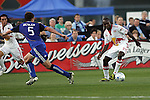 23 April 2009:  Matthew Mbuta (14) of the Red Bulls changes direction on Matt Besler (5) of the Wizards.  The MLS Kansas City Wizards defeated the visiting New York Red Bulls 1-0 at Community America Ballpark in Kansas City, Kansas.