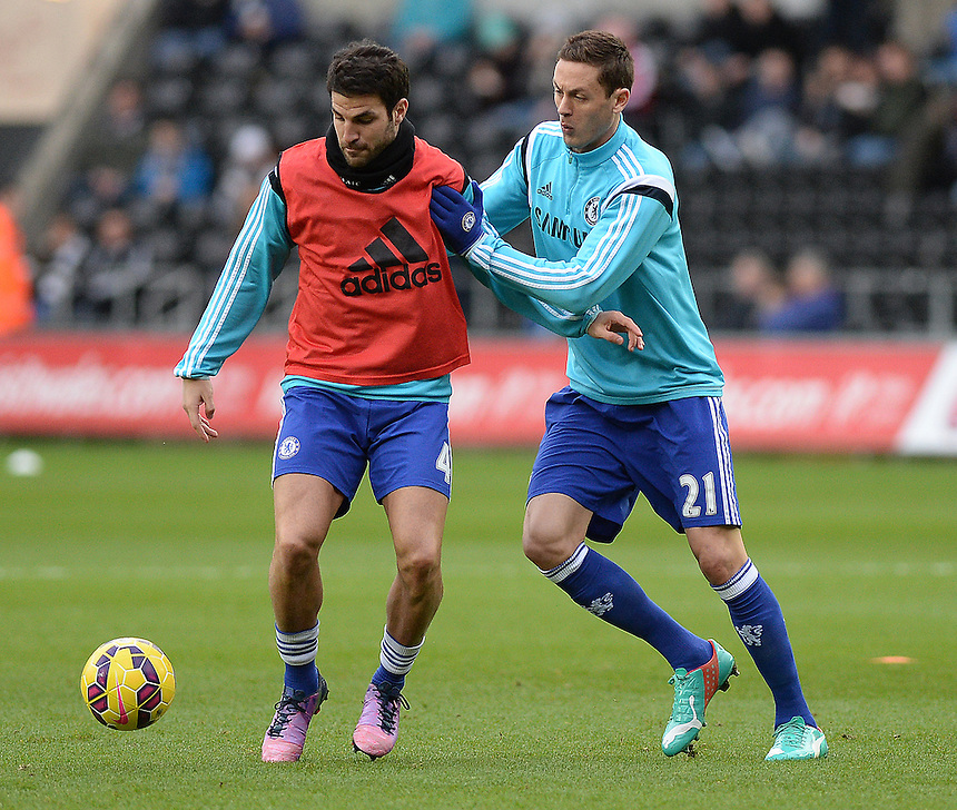 Chelsea's Cesc Fabregas and Nemanja Matic during the pre-match warm-up <br /> <br /> Photographer /Ashley CrowdenCameraSport<br /> <br /> Football - Barclays Premiership - Swansea City v Chelsea - Saturday 17th January 2015 - Liberty Stadium - Swansea<br /> <br /> &copy; CameraSport - 43 Linden Ave. Countesthorpe. Leicester. England. LE8 5PG - Tel: +44 (0) 116 277 4147 - admin@camerasport.com - www.camerasport.com