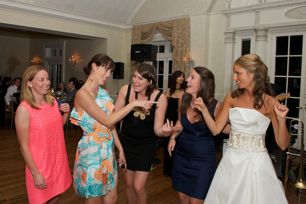 The bride on the dance floor with some friends.