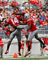 Ohio State Buckeyes linebacker Joshua Perry (37 center) celebrates with Ohio State Buckeyes linebacker Curtis Grant (14) and Ohio State Buckeyes safety Chris Worley (35) after intercepting a pass during Saturday's NCAA Division I football game at Ohio Stadium in Columbus on September 13, 2014. Ohio State won the game 66-0. (Dispatch Photo by Barbara J. Perenic)