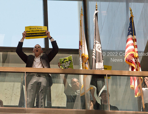 Protestors chanting &quot;Healthcare is a right&quot; stage a sit-in outside the office of United States Senator Lisa Murkowski (Republican of Alaska) in the Hart Senate Office Building in Washington, DC on Wednesday, June 28, 2017.<br /> Credit: Ron Sachs / CNP