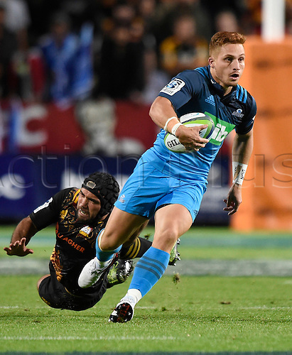 08.04.2016. Hamilton, New Zealand.  Ihaia West breaks the diving tackle during the Blues versus Chiefs Super Rugby match at Waikato Stadium, Hamilton, New Zealand. Friday 8 April 2016.