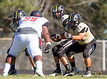 Palos Verdes, CA 09/25/15 - Daniel Schubert (Peninsula #18), Andres Park (Peninsula #71) and Deon Joshua (Lawndale #99) in action during the Lawndale - Palos Verdes Peninsula Varsity football game at Peninsula High School.