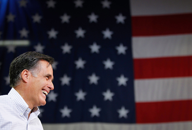 Presidential hopeful Mitt Romney smiles during a town hall meeting to discuss jobs and the economy in Cedar Rapids on December 9.