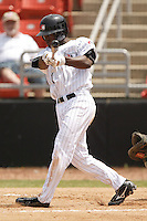 Hickory center fielder Andrew McCutchen (1) follows through on his swing versus Asheville at L.P. Frans Stadium in Hickory, NC, Sunday, May 21, 2006.  Hickory defeated Asheville 5-4.