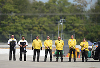 Sept. 30, 2012; Madison, IL, USA: NHRA Safety Safari stands at the National Anthem before the beginning of the race during the Midwest Nationals at Gateway Motorsports Park. Mandatory Credit: Mark J. Rebilas-