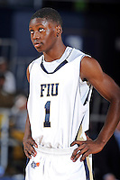 12 January 2012:  FIU guard Deric Hill (1) watches as a teammate shoots a free throw in the second half as the Middle Tennessee State University Blue Raiders defeated the FIU Golden Panthers, 70-59, at the U.S. Century Bank Arena in Miami, Florida.
