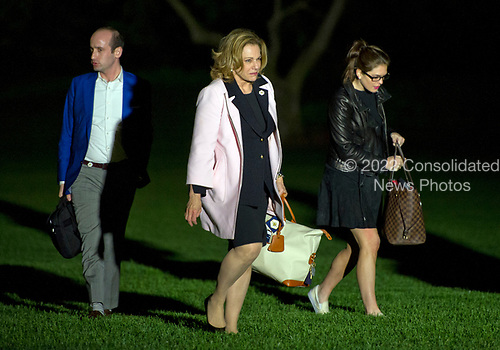 From left to right: Senior Advisor Stephen Miller, Deputy National Security Advisor K. T. McFarland, and White House Director of Strategic Communications Hope Hicks <br /> walk on the South Lawn of the White House in Washington, DC after returning with United States President Donald J. Trump from a weekend trip to the Trump National Golf Club in Bedminster, New Jersey on Sunday, May 7, 2017.<br /> Credit: Ron Sachs / Pool via CNP