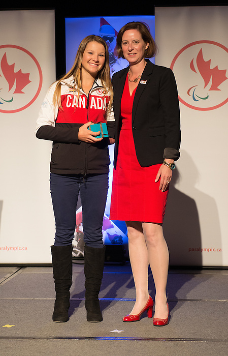 Calgary, AB - June 5 2014 - Brittany Hudak, of CIBC, receives her Paralympic ring from Monique Giroux during the Celebration of Excellence Paralympic Ring Reception in Calgary. (Photo: Matthew Murnaghan/Canadian Paralympic Committee)