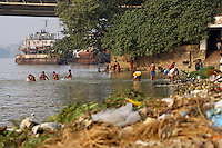 People bathe in the Ganges River in central Kolkata.<br /> <br /> To license this image, please contact the National Geographic Creative Collection:<br /> <br /> Image ID: 1925775 <br />  <br /> Email: natgeocreative@ngs.org<br /> <br /> Telephone: 202 857 7537 / Toll Free 800 434 2244<br /> <br /> National Geographic Creative<br /> 1145 17th St NW, Washington DC 20036