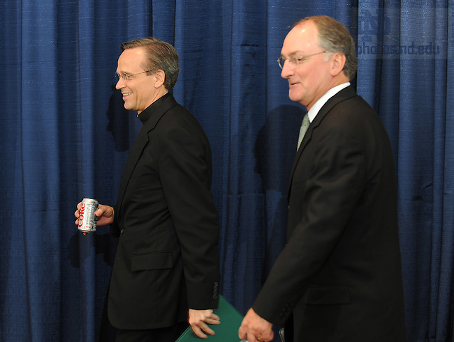 Jul. 16, 2008; South Bend, IN, USA; Rev. John I. Jenkins, C.S.C., president of the University of Notre Dame and Jack Swarbrick enter the room before Swarbrick was announced as athletic director for the University of Notre Dame in South Bend, Indiana. Mandatory Credit: Matt Cashore-US PRESSWIRE