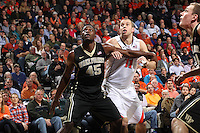 Wake Forest forward Arnaud William Adala Moto (45) looks for the rebound next to Virginia forward Evan Nolte (11) during the game Wednesday Jan. 08, 2014 in Charlottesville, Va. Virginia defeated Wake Forest 74-51.