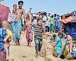 A boy flies a kite the Jamtoli Refugee Camp near Cox's Bazar, Bangladesh. More than 600,000 Rohingya refugees have fled government-sanctioned violence in Myanmar for safety in this and other camps in Bangladesh.