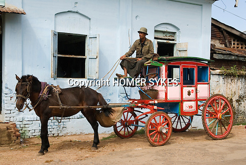 A traditional Victorian miniature horse drawn  stagecoach, they are as taxis. Maymyo Pyin U Lwin. Myanmar Burma.)