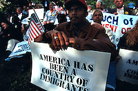 (970522-SWR03)--File Photo -- New York, NY -- Thousands of immigrants who gathered in Battery Park, in the shadow of the Statue of Liberty and Ellis Island, for a Rally for Immigrants Rights.  Photo © Stacy Walsh Rosenstock