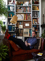 Jason Rand in his living room; the vintage floor lamp is Italian.