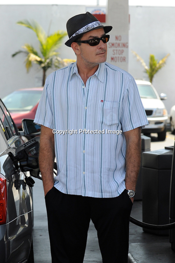 June 5th 2010...Charlie Sheen pumping gas into his Mercedes car in Sherman Oaks California.. Charlie seemed pretty happy even though he's going to jail in a few days.  Charlie posed & smiled for the cameras as the photographers joked about his jail sentence. ...AbilityFilms@yahoo.com.805-427-3519.www.AbilityFilms.com
