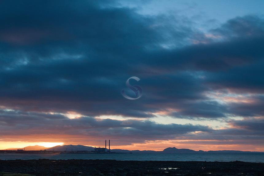 Cockenzie Power Station and Edinburgh from Longniddry Bents at sunset, East Lothian