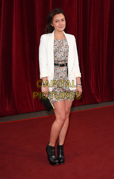 LACEY TURNER .'An Audience with Michael Buble' Red Carpet arrivals at the London ITV Studios, South Bank, London, England. .May 3rd 2010 .full length bracelets white jacket pink blue white pattern print dress ankle boots black clutch bag .CAP/ROS.©Steve Ross/Capital Pictures.