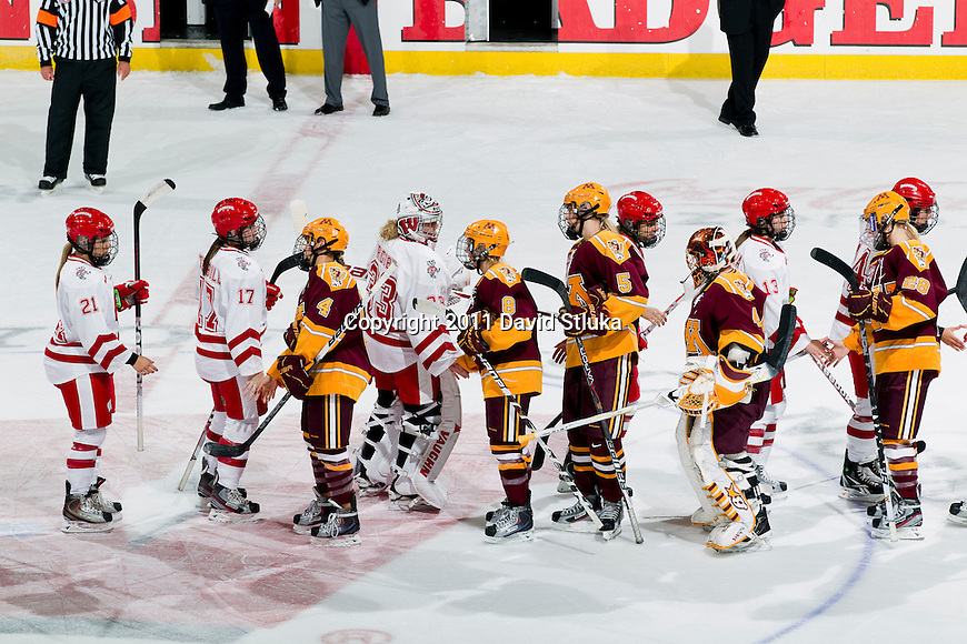 Wisconsin Badgers shake hands with the Minnesota Golden Gophers after an NCAA women's hockey game on October 14, 2011 in Madison, Wisconsin. The Badgers won 3-2. (Photo by David Stluka)