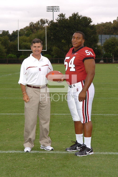 7 August 2006: Stanford Cardinal head coach Walt Harris and Ekom Udofia during Stanford Football's Team Photo Day at Stanford Football's Practice Field in Stanford, CA.