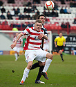 Accies Andy Ryan holds off Raith's Laurie Ellis.