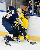 Sean Lorenz (Notre Dame - 24), Rhett Bly (Merrimack - 27) - The University of Notre Dame Fighting Irish defeated the Merrimack College Warriors 4-3 in overtime in their NCAA Northeast Regional Semi-Final on Saturday, March 26, 2011, at Verizon Wireless Arena in Manchester, New Hampshire.