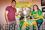 Helen McCrohan and Julie May Kelly in the Sam Maguire Cup with Kerry footballer, Aidan O'Mahony at the Top of Coom.