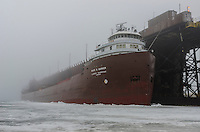 The 731 ft. Kaye E. Barker at Marquette's Upper Harbor dock after traveling through a nearly frozen Lake Superior. Marquette, MI