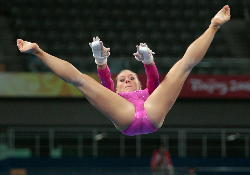 Nastia Liukin, of the USA gymnastic team trains on the uneven bars in Beijing ahead of the 2008 Olympics.
