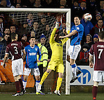 Jon Daly defends the cross ball then flattens Cammy Bell