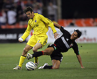 7 May 2005.  DC United's Christian Gomez (10) tackles the ball away from Frankie Hejduk (2) of the Columbus Crew at RFK Stadium in Washington, DC.