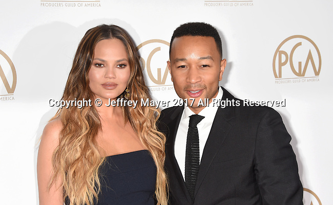 HOLLYWOOD, CA - JANUARY 28: Model Chrissy Teigen (L) and singer-songwriter-musician-actor John Legend arrive at the 28th Annual Producers Guild Awards at The Beverly Hilton Hotel on January 28, 2017 in Beverly Hills, California.