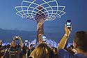 Visitors of Expo 2015 film with their smartphone the spectacle of the Tree of Life at the Lake Arena, Rho-Pero, Milan, in June 2015. The Tree of Life is the symbol of Italy pavilion and is the most evocative lure for visitors. &copy; Carlo Cerchioli<br /> <br /> Visitatori di Expo 2015 riprendono con i loro smartphone lo spettacolo dell'Albero della vita alla Lake Arena, Rho-Pero, Milano, giugno 2015. L'Albero della vita &egrave; il simbolo di Padiglione Italia ed &egrave; il richiamo pi&ugrave; suggestivo per i visitatori di Expo.