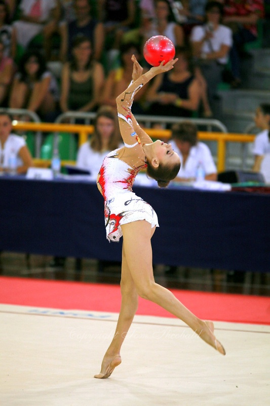 Evgeniya Kanaeva of Russia balances with ball on way to winning senior All-Around at 2006 Trofeo Cariprato in Prato, Italy on June 17, 2006.  (Photo by Tom Theobald)