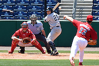 Tampa Yankees designated hitter Dante Bichette Jr. (25) at bat in front of catcher Logan Moore (10) and umpire Brennan Miller during a game against the Clearwater Threshers on April 9, 2014 at Bright House Field in Clearwater, Florida.  Tampa defeated Clearwater 5-3.  (Mike Janes/Four Seam Images)