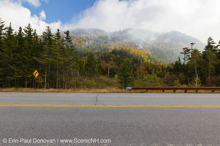 Smoke from a forest fire on Dilly Cliff in Kinsman Notch, New Hampshire in October 2017. These cliffs are located behind the Lost River Gorge and Boulder Caves on Route 112 in North Woodstock.