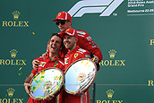 25th March 2018, Melbourne Grand Prix Circuit, Melbourne, Australia; Melbourne Formula One Grand Prix, race day; Scuderia Ferrari; Sebastian Vettel wins race, and holds up trophy with team mate Kimi Raikkonen