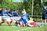 VOETBAL: SURHUISTERVEEN: Sportpark 't Ketting, 12-05-2012, Zaterdag 2e Klasse I, vv 't Fean '58 - SDS, Eindstand 2-1, Jeroen Til (#5) wordt bedolven onder zijn medespelers nadat hij 't Fean '58 in blessuretijd op een 2-1 voorsprong heeft gezet, vlnr Wietze Vrij (#15), Ale Lanting (#3), Jeroen Til (#5), Edbert Groen (#11), Atze van der Veen (#12), ©foto Martin de Jong